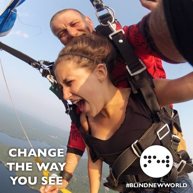 "Woman skydives with an instructor. Text reads ""Change the way you see"" with the #BlindNewWorld logo."