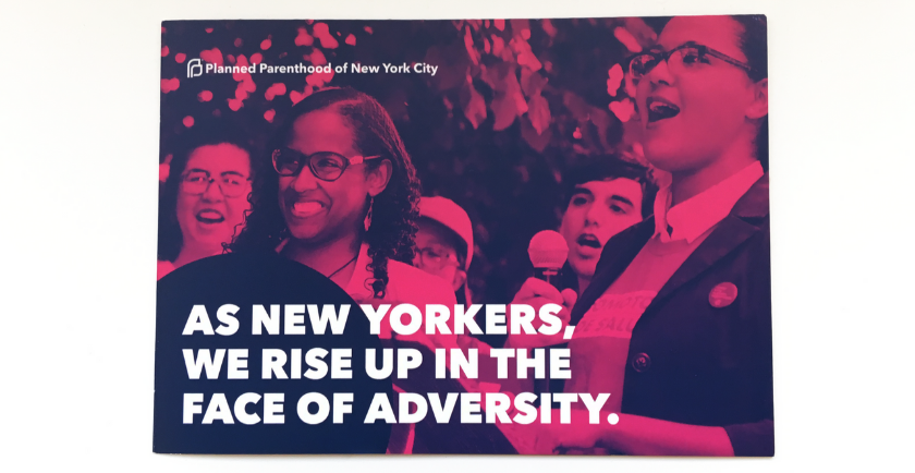 Photograph of printed mailer for Planned Parenthood. Text: As New Yorkers, we rise up in the face of adversity.